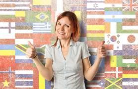 Student in front of flags